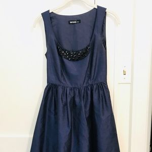 Silk navy dress with beaded detailing at neckline